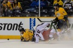 Craig Smith gets tied up with former RPI Engineer Jerry D'Amigo. (Jim Diamond/Rinkside Report)