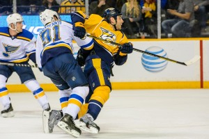 Eric Nystrom absorbs a hit from Vladimir Tarasenko (Jim Diamond/Rinkside Report)