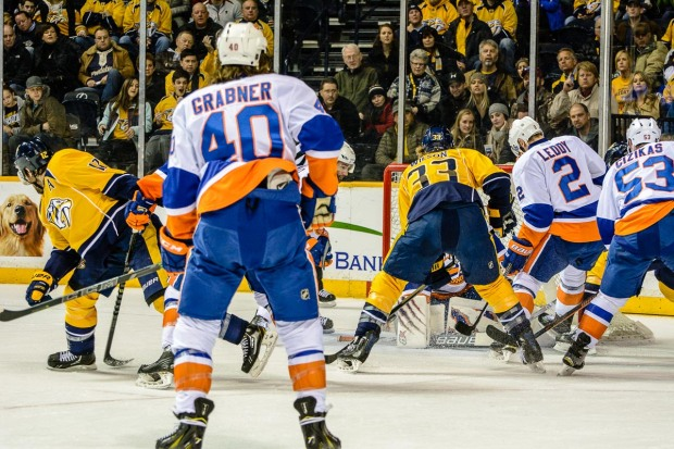 Colin Wilson scores against the Islanders. (Jim Diamond/Rinkside Report)