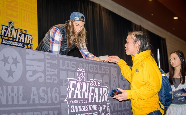 Hilary Knight signs an autograph for a fan. (Jim Diamond/Rinkside Report)